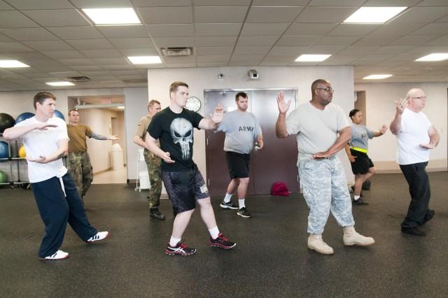 Students practice tai chi at the Towle Courts Fitness Center at Fort Bragg, N.C., March 21, 2012. The class is offered to injured and wounded warriors and other interested clients as a way to improve flexibility, reduce stress and increase coordination and strength.