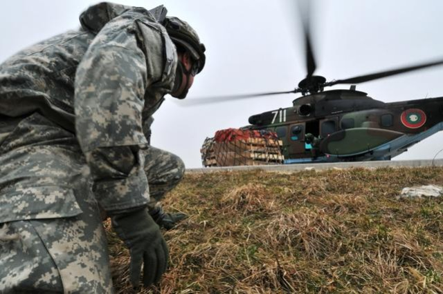 1st. Lt. Dustin Dunbar, with Alpha Company, 173rd Brigade Support Battalion, 173rd Airborne Brigade Combat Team, prepares to approach a Eurocopter AS532 Cougar helicopter during a sling-load training exercise at the Joint Multinational Readiness Center in Hohenfels, Germany, March 14, 2012. The Soldiers were conducting a mission rehearsal exercise at the JMRC in preparation for an upcoming deployment to Afghanistan.