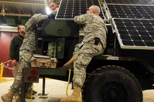 Soldiers of the 173rd Airborne Brigade Combat Team install a solar panel to an energy-efficient generator during specialty training hosted as part of the units Mission Rehearsal Exercise at the Joint Multinational Readiness Center in Hohenfels, Germany, March 6, 2012.  The launch of the new energy-efficient equipment is part of the Rapid Equipping force's Energy to the Tactical Edge, or E2E, initiative, a subset of the Army's Net Zero effort.