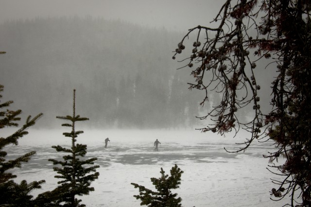 Special Forces Master Mountaineering Course students cross a frozen Bear Lake, toward a course training event, Feb. 21 at Rocky Mountain National Park in Estes Park, N.C.