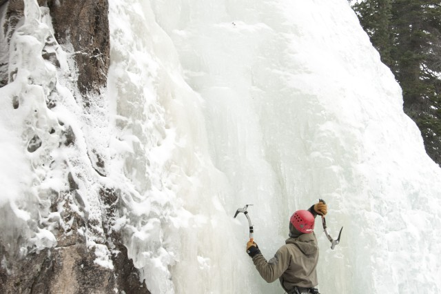A Special Forces Master Mountaineering Course instructor climbs an icy cliff using picks and crampons in order to demonstrate proper techniques for his students below, during a training exercise Feb. 22 at Rocky Mountain National Park in Estes Park, Co.
