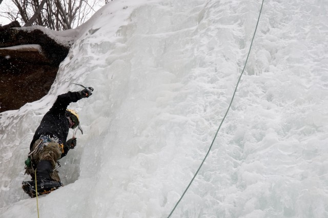A Special Forces Master Mountaineering Course student climbs an icy cliff using ice picks and crampons during a training exercise Feb. 22 at Rocky Mountain National Park in Estes Park, Co.