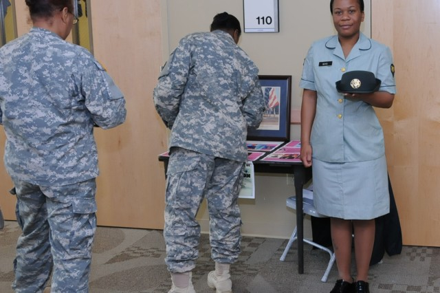 Sgt. Neisha Boyd (wearing Spc.) models a 1970's era women's Army uniform during Women's History Month activites at Fort Jackson, SC on March 28. The orignal uniform was donated to the 81st Regional Support Command historian Dr. John Boyd (no relation to Sgt. Boyd).