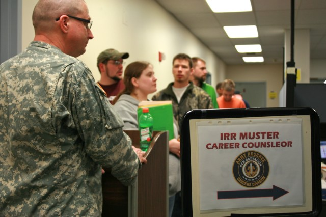 Individual Ready Reserve Soldiers wait in line to speak to Army Reserve career counselors that update their contact information and offer reenlistment opportunities March 31 during a muster at Fort Snelling, Minn. The Army Human Resources Command sent orders to Individual Ready Reserve Soldiers to participate in the muster to assess, update, and certify their readiness. (U.S. Army photo by Sgt. 1st Class Osvaldo Sanchez, 88th Regional Support Command Public Affairs)