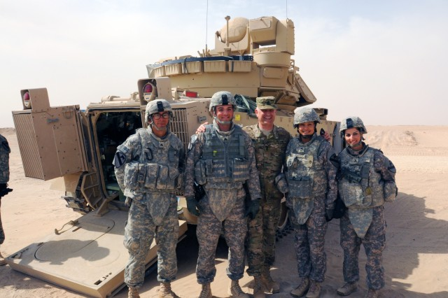 Sgt. Maj. of the Army Raymond F. Chandler III poses with Fort Hood, Texas, Soldiers from the 1st Heavy Brigade Combat Team, 1st Cavalry Division, at Udari Range, Kuwait, April 1, 2012. During his visit throughout the region, Sgt. Maj. of the Army Chandler briefed more than 1,000 Third Army Soldiers on upcoming changes to the Army's retention policy, the new Army Physical Readiness Test, and future alterations being implemented to the Army Combat Uniform, while receiving essential feedback and ideas for improvements from troops. Chandler's visit furthered Third Army's initiative to communicate for success by allowing Soldiers, the strength of the nation, to provide essential feedback and voice their insight on how to improve the Army as a whole for years to come.
