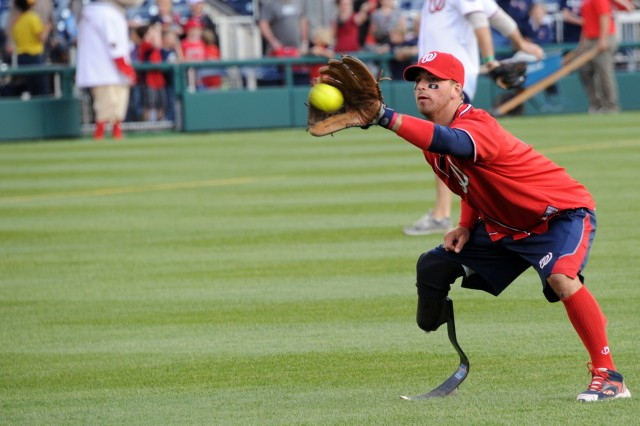 A wounded warrior makes the catch during warmup before the Amputee Softball Team exhibition game at Washington Nationals Stadium in Washington, D.C., April 3, 2012.