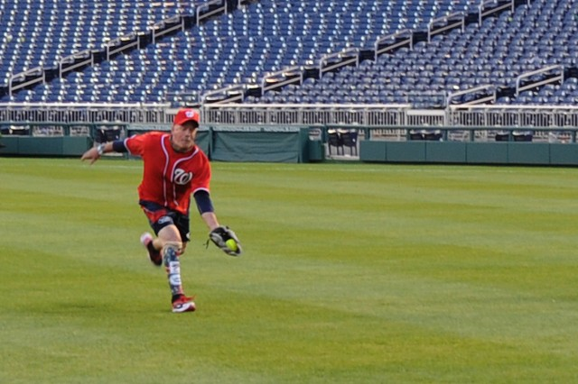 A wounded warrior makes the play in the outfield during an Amputee Softball Team exhibition game at Washington Nationals Stadium in Washington, D.C., April 3, 2012.
