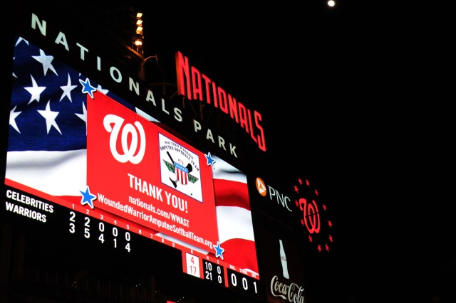 The billboard at National Park thanks wounded warriors on the Amputee Softball Team during their exhibition game against celebrities at Washington Nationals Stadium in Washington, D.C., April 3, 2012..