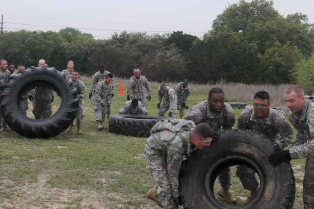FORT HOOD, Texas --Teams with 3rd Brigade Special Troops Battalion, 3rd Brigade Combat Team, 1st Cavalry Division, roll tires as part of a physical training competition at the Battalion Ave. Baseball Fields Mar. 28, 2012.