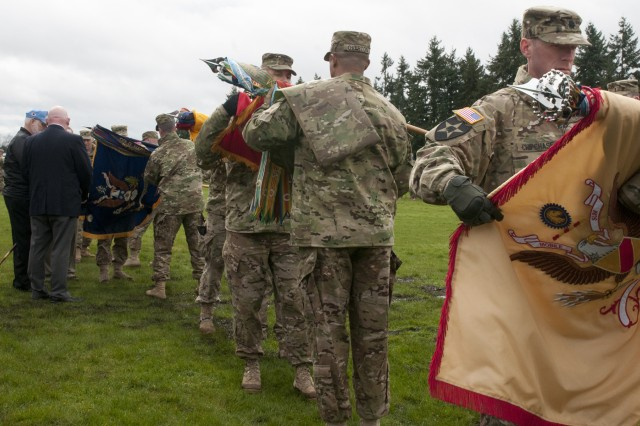 "The 2nd Stryker Brigade Combat Team, 2nd Infantry Division battalion commanders case their colors during 2/2 ID's deployment ceremony on Watkins Field at Joint Base Lewis-McChord, March 30.The six battalions that make up the ""Lancer"" Brigade will conduct missions in support of the brigade's overall objective during their deployment to Afghanistan in support of Operation Enduring Freedom."