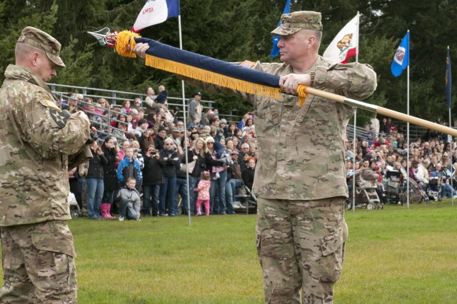 Colonel Barry Huggins, commander 2nd Stryker Brigade Combat Team, 2nd Infantry Division and Command Sgt. Maj. Andrew Connette, command sergeant major, 2/2 ID, case the brigade's colors during a ceremony on Watkins Field at Joint Base Lewis-McChord, March 30.