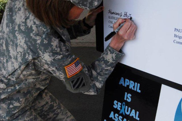 Col. Kathleen Gavle, United States Army Garrison-Daegu commander, signs the Sexual Assault Awareness Proclamation April 4 at the 19th Expeditionary Sustainment Command headquarters on Camp Henry. The proclamation signing, done by Gavle and Brig. Gen. Paul C. Hurley, 19th ESC commander, marked the beginning of Sexual Assault Awareness Month.