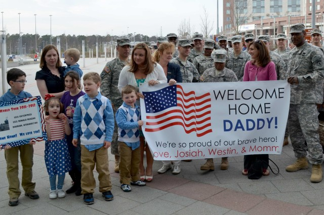 Families and fellow 19th Battlefield Coordination Detachment Soldiers welcomed home three of their own recently at Ramstein Air Base, Germany.