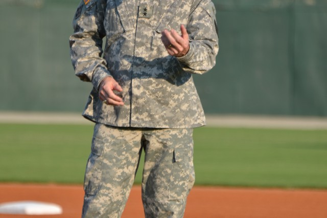 Maj. Gen. James Milano prepares to throw out the first pitch before a Columbia Blowfish baseball game last year. Milano, who will relinquish command Tuesday, praised the cooperation between Fort Jackson and various off-post individuals and organizations.