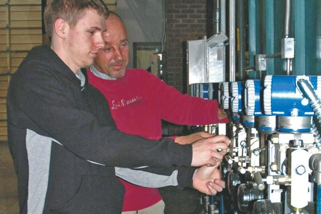 Kyle Goulden (left) checks the gauges in the boiler operated by the Aberdeen Proving Ground Directorate of Public Works as Don Keithley, DPW utilities leader, looks on. Goulden, then a Harford Technical High School senior, worked for DPW while participating in HIRED!, a Family and Morale, Welfare and Recreation apprenticeship program. More than 40 teens are enrolled for the upcoming summer HIRED! program.