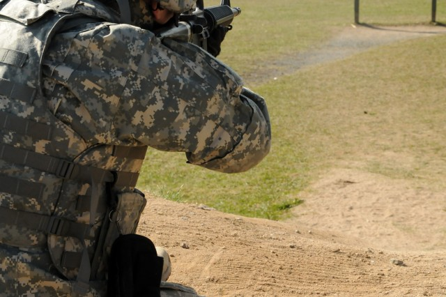 Staff Sgt. Francisco Sandoval, HHC, USAG Ansbach, shoots his M16A2 during a weapons qualification round of the competition.