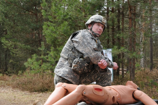 Staff Sgt. Robert Donovan, USAG Kaiserslautern, demonstrates his knowledge of heat-related injuries during the Warrior Tasks and Drills portion. Donovan was named the 2012 IMCOM-Europe NCO of the Year.