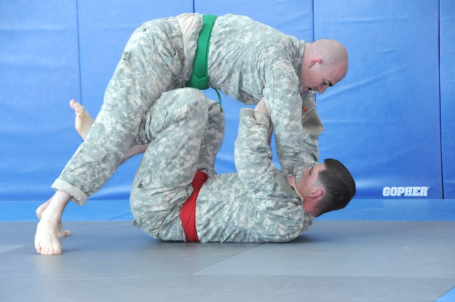 Staff Sgt. Stephen Cribben, USAG Baumholder, gets the advantage over Staff Sgt. Ryan Barnard, HHC, USAG Grafenwoehr, during the combatives portion of the competition. Cribben's victory was short-lived, however, as Barnard went on to win the brawl 8-2.