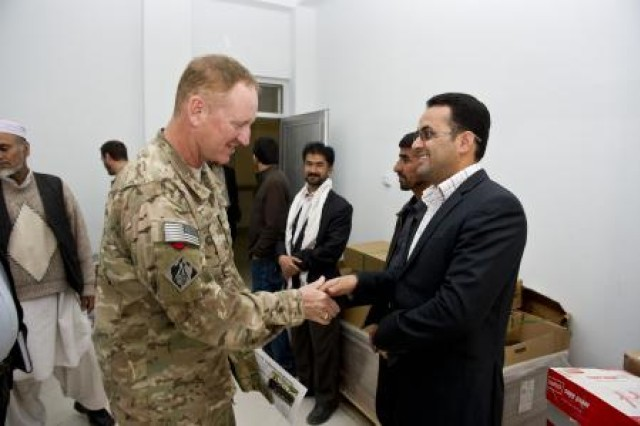 Air Force Col. Ben Wham speaks with a faculty member of the Herat University engineering program.  Wham is commander of the U.S. Army Corps of Engineers Afghanistan Engineer District South. The district has projects to provide engineering texts, lab equipment and other materials to the engineering departments of Herat and Kandahar universities, to increase the capacity to train engineers in Afghanistan.