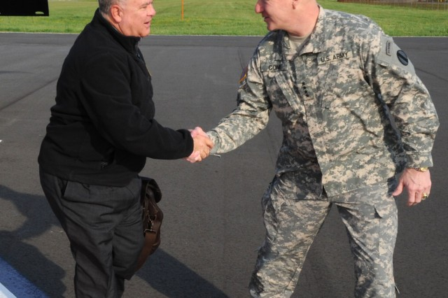 Joseph W. Westphal, undersecretary of the Army, is greeted by Gen. Robert W. Cone, commanding general of U.S. Army Training and Doctrine Command, upon his arrival to Joint Base Langley-Eustis, Va., April 4, 2012. During Westphal's visit, he met with TRADOC senior leaders at Fort Eustis to learn more about the command's top initiatives and how the initiatives are prioritized to shape the future force -- the Army of 2020.