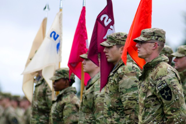 """JOINT BASE LEWIS-MCCHORD, Wash. (March 30, 2012) Soldiers from 2nd BSB, 2nd Bde., 2nd Inf. Div. grasp their respective company colors at Watkins Field, March 30. The """"Mustang"""" Battalion joined fellow Soldiers of the """"Lancer"""" Brigade in casing colors in preparation for deployment this spring."""