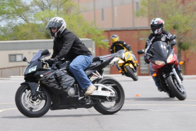 Soldiers practice safely maneuvering between cones during the military sport bike rider course March 30.