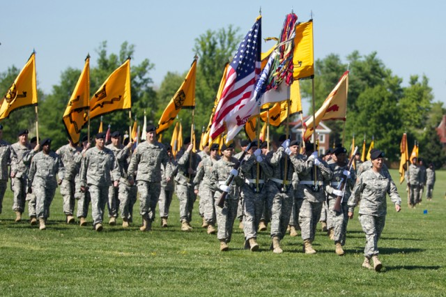 Col. Peggy Combs, Cadet Command's deputy commanding general, leads the colors and brigade commanders during the ceremony.
