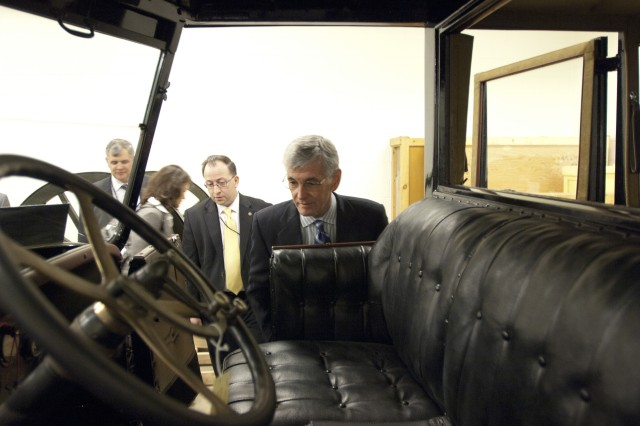 Secretary of the Army John McHugh looks inside the 1917 Locomobile staff car of Gen J.J. Pershing's from World War I, one of many rare items archived at the Center of Military History Museum Support Facility, during his visit April 2, 2012, at Fort Belvoir, Va. (U.S. Army photo by Spc. John G. Martinez)