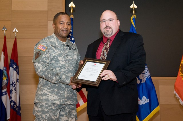 Maj. Gen. Robert S. Ferrell, commanding general Communications-Electronics Command, presents Richard Albietz, Senior Internal Review Evaluator, a Two Star Note recognizing him as the recipient of the Army FY11 Resource Management Individual Award for Analysis/Evaluation.