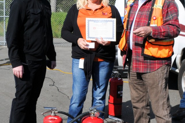 (From left) Jason Walsh and Sue Fox, safety specialists; and Dan Williams, safety officer from the U.S. Army Corps of Engineers Sacramento District, prepare to award certificates of completion for the yearly fire extinguisher safety training in Folsom, Calif., April 7, 2012. The training, mandated by Occupational Safety and Health Administration and conducted by the district's safety office, included a video presentation, group discussion, followed by a timed live-fire exercise. (U.S. Army photo by Todd Plain/Released)