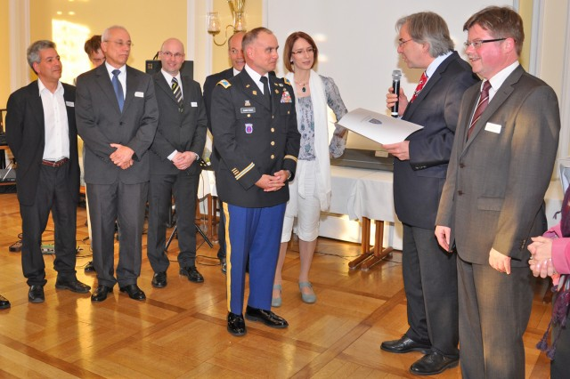 Wiesbaden Lord Mayor Dr. Helmut Müller reads a citation while recognizing the U.S. Army Garrison Wiesbaden for its environmental efforts to improve the Rheinblick Golf Course during a ceremony at Wiesbaden City Hall March 27.
