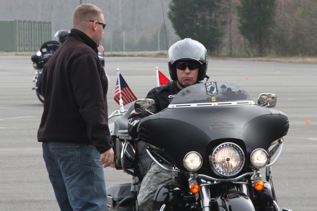 """QUANTICO, Va. -- """"Look all the way through the curve,"""" an instructor for the Motorcycle Safety Federation tells Command Sgt. Michael Buxbaum, U.S. Army Corps of Engineers Command Sgt. Major, during the Basic Riders Course II March 16 at Marine Corps Base Quantico."""