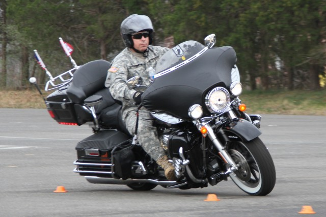 QUANTICO, Va. -- Command Sgt. Maj. Michael Buxbaum, command sergeant major of the U.S. Army Corps of Engineers, maneuvers his Harley-Davidson Ultra Classic through an S-curve during the Basic Riders Course II March 16 at Marine Corps Base Quantico.