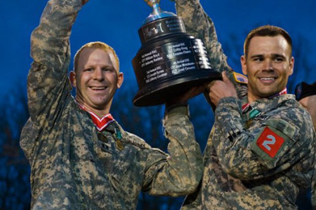Capt. John Chambers, left, and Capt. Joe Riley hoist the Best Sapper trophy into the air after winning the competition in 2011. Both Groves and Chambers are now helping to design the Best Sapper competition for 2012.