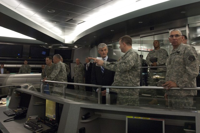 """Col. Jeffery Schilling, chief of current operations, briefs Secretary of the Army John McHugh on the functions and activities on the """"watch floor"""" at U.S. Army Cyber Command during McHugh's visit April 2, 2012, Fort Belvoir, Va. Lt. Gen. Rhett A. Hernandez, commanding general, Army Cyber Command/2nd Army hosted McHugh during his visit to the newest Army Service Component Command.  (U.S. Army photo by Spc. John G. Martinez)"""