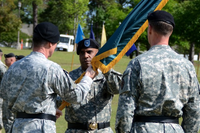 Brig. Gen. Bryan Roberts, center, receives the colors of Fort Jackson during a Change of Command ceremony April 10 at the Fort Jackson Officers' Club. Roberts is Fort Jackson's 45th commanding general, following Maj. Gen. James Milano. Roberts is the former deputy commander of the U.S. Army Recruiting Command at Fort Knox, Ky.