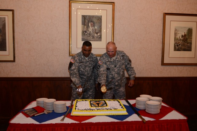 Brig. Gen. Bryan Roberts, left, and Post Command Sgt. Major Kevin Benson cut a cake during Tuesday's welcoming celebration of Fort Jackson's new commanding general.