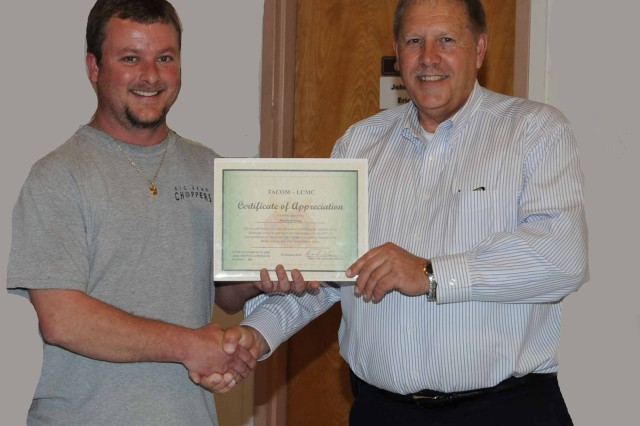 Marty Owen receives certificate of appreciation from TACOM