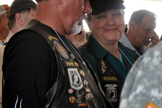 Audience members react during Fort Irwin's Vietnam-era Veterans Welcome Home ceremony, April 4, 2012.