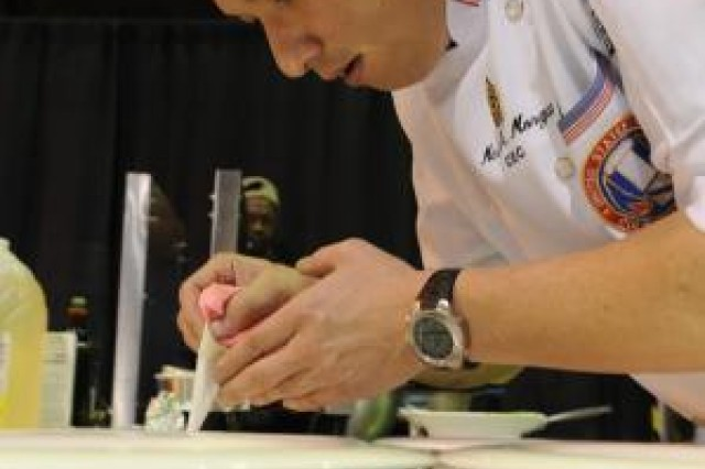 U.S. Army Sgt. Maj. Mark Morgan with the USA Culinary Team sets plates during the International Two-Chef Mystery Competition in Fort Lee, Va., Feb. 29, 2012. All military branches competed in several categories during the 37th Annual Military Culinary competition.  Photo by Spc. Daneille Hendrix, Combined Arms Support Command