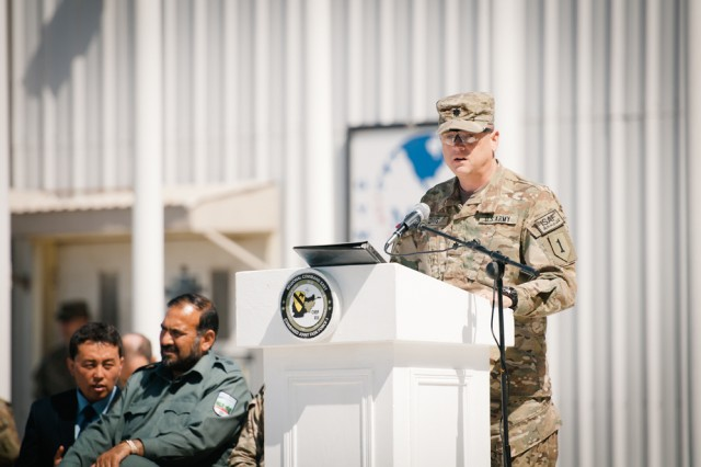 Lt. Col. James Davis, commander of the 1st Infantry Division Headquarters and Headquarters Battalion and Task Force Defender, gives a speech at a transfer of authority ceremony on Bagram Airfield, Afghanistan, April 12.
