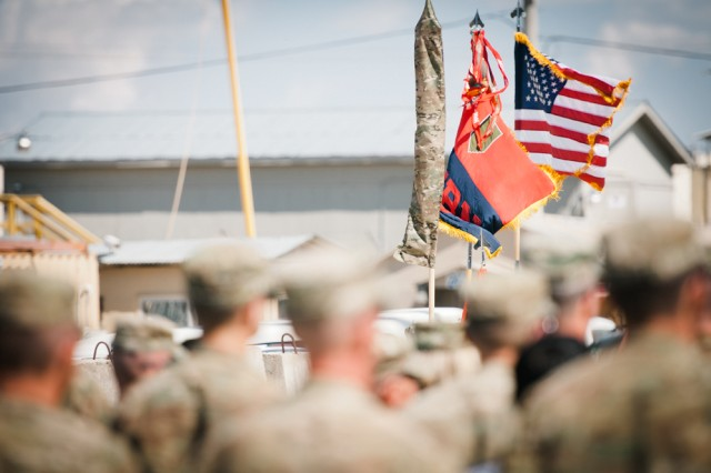 The colors of the 1st Infantry Division Headquarters and Headquarters Battalion flies next to the national colors following a transfer of authority ceremony April 12 on Bagram Airfield, Afghanistan. The battalion replaced the 1st Cavalry Division's headquarters battalion, becoming Task Force Defender and assuming responsibility of operations in the Parwan province.