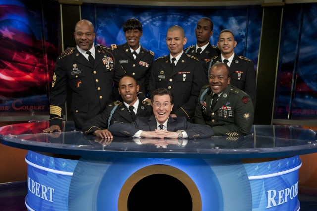 Soldiers and Family members of the New York Army National Guard's 727th Military Police Law and Order Detachment, the369th Sustainment Brigade and 1st Battalion, 69th Infantry Regiment gather around Stephen Colbert, host of The Colbert Report after his conversation with first lady Michelle Obama, on the first anniversary promoting Joining Forces,  a national initiative led by the first lady and Dr. Jill Biden that mobilizes all sectors of society to give our service members and their families the opportunities and support they have earned.