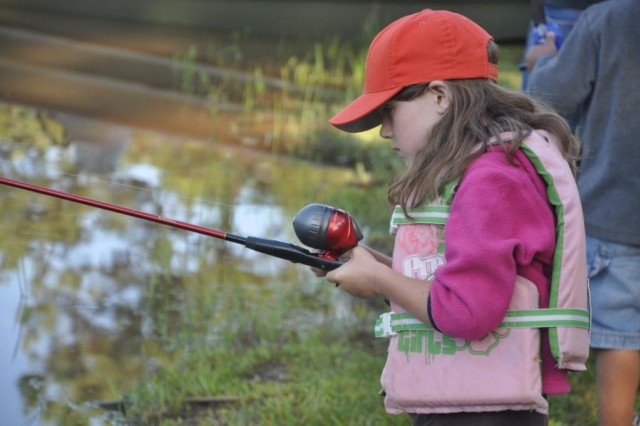 A child casts her rod in hopes to land a catfish at last years' Kid's Fishing Derby hosted by the Army Corps of Engineers at Lake Richard B. Russell in Calhoun Falls, S.C.