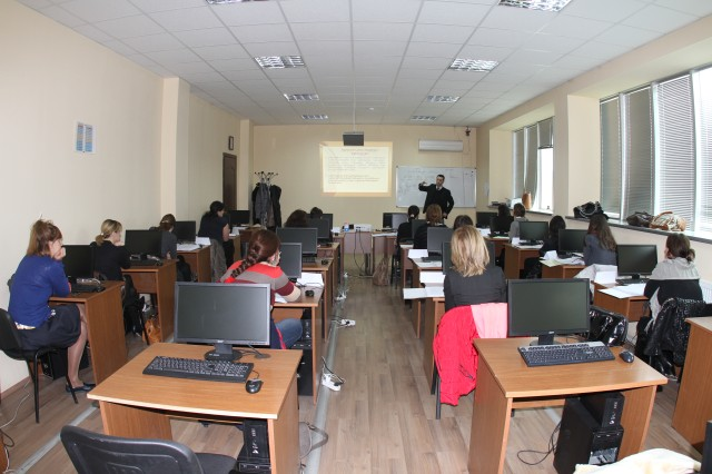 In a classroom in the three-story building designed to house as both class and dorm rooms, cadets at the Tbilisi Police Academy learn critical police procedures.