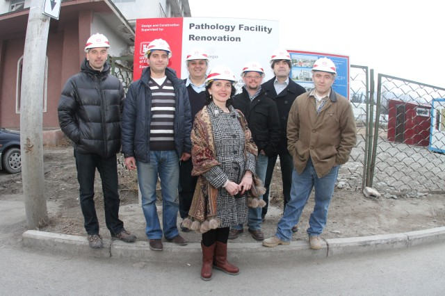 The U.S. Army Corps of Engineers Europe District's Caucasus Resident Office, pauses for a photo with his team at the pathology lab renovation site in Tbilisi, Georgia, Feb. 29, 2012.