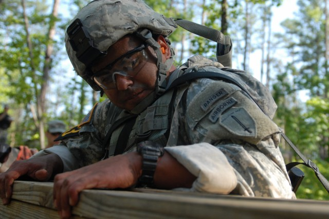 FORT BENNING, Ga. -- Army Sgt. 1st Class Vince Castellanos, from the Ranger Training Brigade, climbs an obstacle during the 29th Annual David E. Grange Jr. Best Ranger Competition at Todd Field, April 14, 2012. The obstacle was part of the Ranger First Responder medical lane.