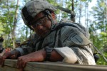 Army Sgt. 1st Class Vince Castellanos climbs an obstacle during the Best Ranger Competition
