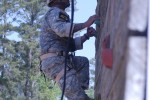 Army Sgt. 1st Class Vince Castellanos climbs up the side of the tri-tower during the Best Ranger Competition