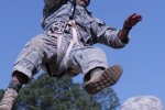 Army Sgt. 1st Class Vince Castellanos attempts to regain footing during the Best Ranger Competition